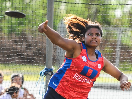 Okkodo High School Bulldogs' Amanda Cruz competes in the discus throwing event during the Independent Interscholastic Athletic Association of Guam Track and Field League All-Island meet at the John F. Kennedy High School field in Tamuning on May 28.