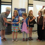 Black Mountain Daisies and Brownies donate cookie money for KaBoom playground