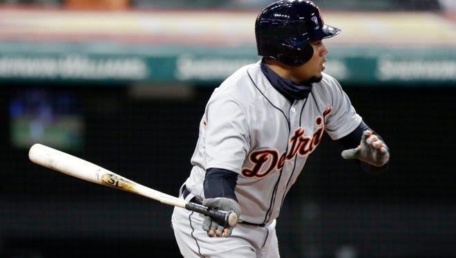 Detroit Tigers' Jeimer Candelario hits a one-run double off Cleveland Indians relief pitcher Dan Otero in the seventh inning of a baseball game, Tuesday, April 10, 2018, in Cleveland. Victor Reyes scored on the play.
