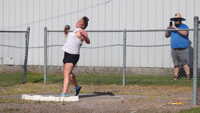 Sault High junior Emily McLean is shown throwing shot put this summer, while coach Brad Boven, right, shoots video for virtual national competition. McLean placed 7th in shot put and 30th in discus in the NSAF x Athletic.net Virtual Nationals.
