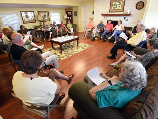 Area residents attend a cancer support group meeting