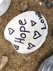 Mourners in Kitty Hawk, N.C., wrote messages on shells,