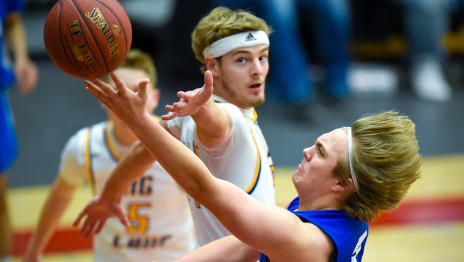 St. Cloud Apollo's Logan Johnson scores against Big Lake during the first half Saturday, Dec. 30, in the Breakdown Granite City Classic at Halenbeck Hall.
