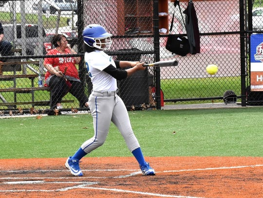Mikayla Adams adds to the Winton Woods RBI total during