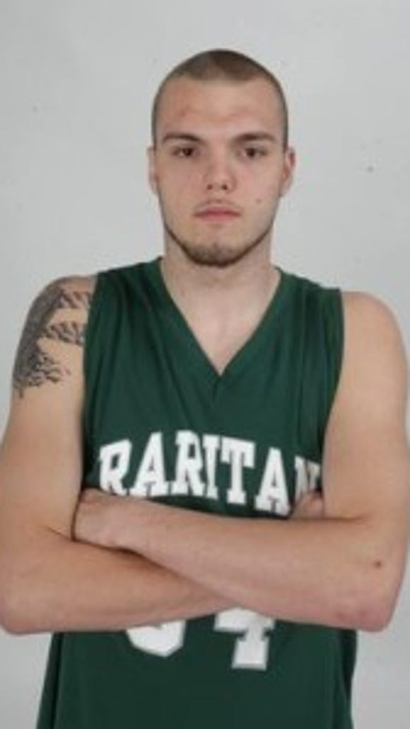 Former Raritan basketball star and two-time Asbury Park Press Player of the Year Mike Aaman shown here posing for his POY photo. Asbury Park Press Staff Photo by Robert Ward