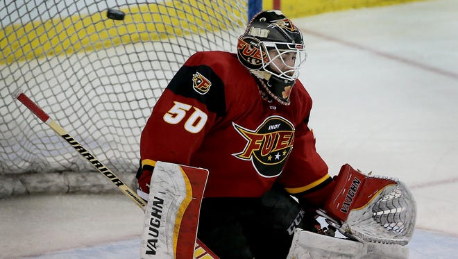 The puck flies by Indy Fuel's goalie Shane Owen for a Fort Wayne Komet goal in the first period of their game. The Indy Fuel defeated the Fort Wayne Komets 3-1 Sunday, Jan 24, 2016, afternoon at the Indiana Farmers Collseum.
