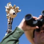 Border Patrol Agent Marcos Soto monitors a remote location at the border using high-tech security cameras.