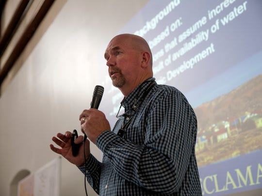 Patrick Page, deputy construction engineer with the U.S. Bureau of Reclamation, gives a presentation on the Navajo-Gallup Water Supply Project Tuesday at the Tsé Alnaozt'i'í Veteran Memorial Building in Sanostee.