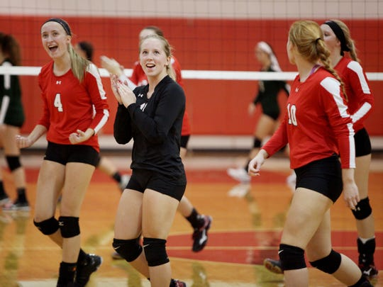 Riverheads' Madison Cash, center, celebrates after scoring during the volleyball game at Riverheads High School on Tuesday, Sept. 27, 2016.