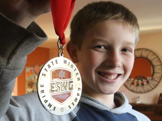 Marcus Mueller, 12, scored a silver medal in the Empire State Winter Games in New York for his age group's luge competition. Mueller has reached speeds of 53 miles per hour and is working to Olympic speeds of more than 80 miles per hour.