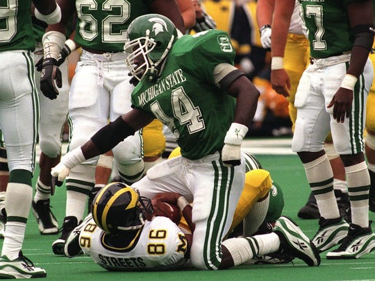 MSU linebacker Ike Reese (44) points to the spot of the down after hitting Michigan receiver Tai Streets (86) Saturday.
