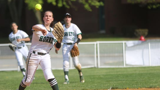 Devyn DiPasquale, of Passaic Valley, tries to throw
