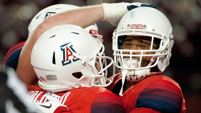 Sept. 19, 2015: Arizona Wildcats wide receiver David Richards (right) is congratulated by quarterback Anu Solomon (12) after scoring a touchdown during the second quarter against the Northern Arizona Lumberjacks at Arizona Stadium.