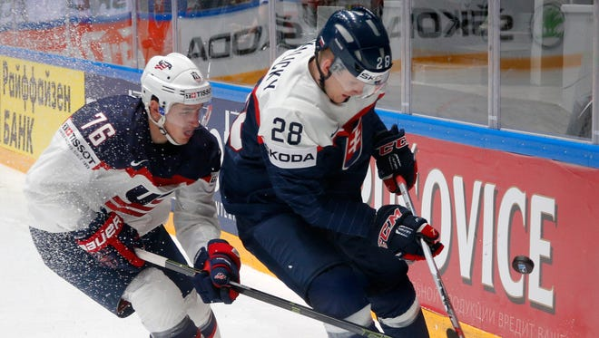 Slovakia''s Pavol Skalicky, right, fights for the puck with Brady Skjei of the U.S. during the hockey world championships in St. Petersburg, Russia, on Tuesday, May 17, 2016.