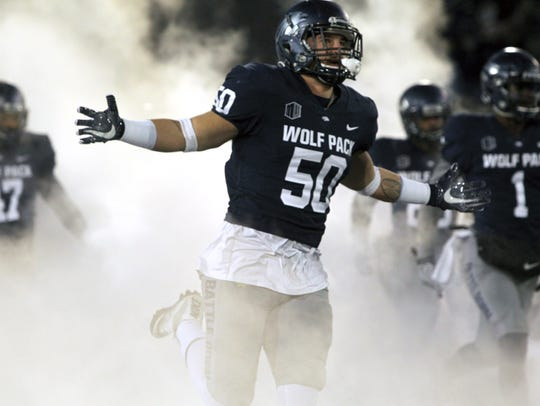 Nevada linebacker Austin Paulhus leads his teammates