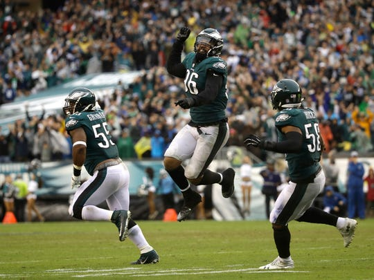 Philadelphia Eagles' Derek Barnett (96) , Brandon Graham (55) and Jordan Hicks (58) celebrate during the second half  against the Indianapolis Colts, Sunday, Sept. 23, 2018, in Philadelphia.