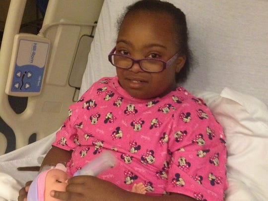 Zion Harris, then 9, recovers from transoral robotic surgery for her sleep apnea.