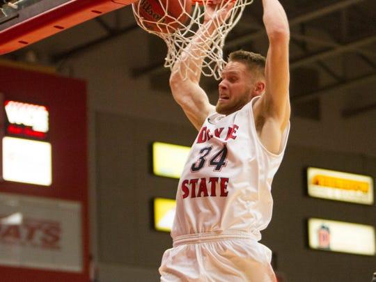 Dixie State forward Zac Hunter dunks the basketball