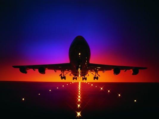 plane-taking-off-at-dusk_large.jpg