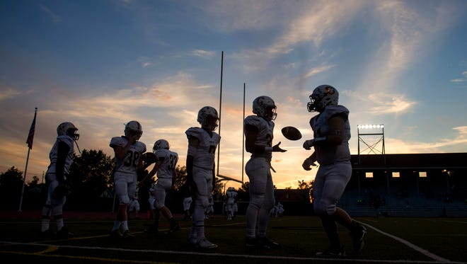 The Central Bears warm up before facing off against the Memorial Tigers at Enlow Field in Evansville, Ind., on Friday, Sept. 29, 2017. Central won 35-7.