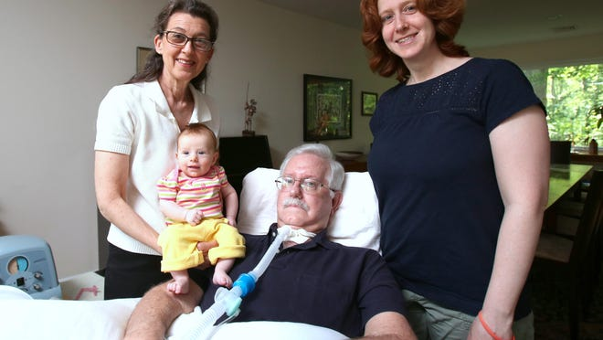Charley Braunfeld of Tappan, who is paralyzed with ALS, with his wife, Bertha, daughter, Jessica and granddaughter, Luna at his Tappan home June 8, 2015. He will be throwing out the first pitch of a Rockland Boulders game on June 10.