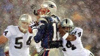 """Charles Woodson (24) and Tom Brady (12), stars of the infamous """"Tuck Rule"""" game."""