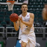 BYU guard Kyle Collinsworth passes off the basketball while taking on New Mexico in the second half of an NCAA college basketball game at the Diamond Head Classic, Wednesday, Dec. 23, 2015, in Honolulu.