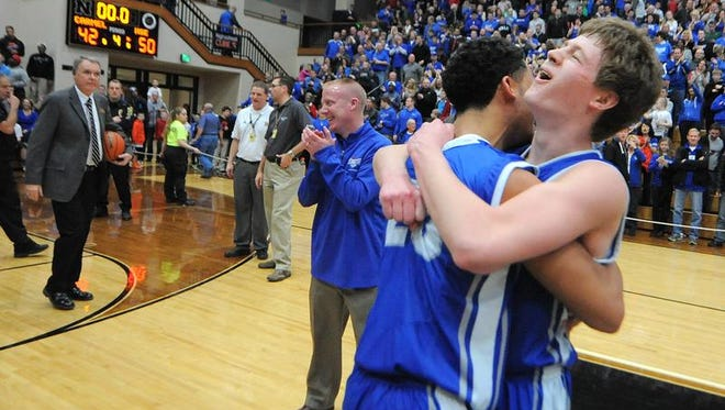 Hamilton Southeastern guard Eric Davidson, right, celebrates with guard Tyler Jenkins after beating Carmel for the Class 4A Sectional #8 championship game, Saturday, March 8, 2014, at Noblesville High School. HSE won the game 50-42.