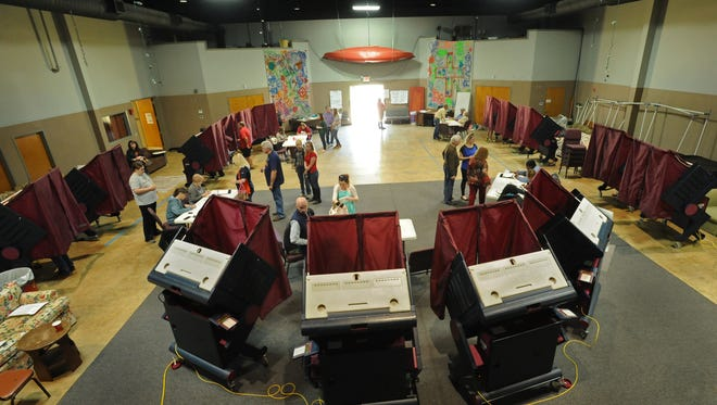 People vote at Shreveport's Grace Community Church in the Presidential Preference Primary election Saturday.