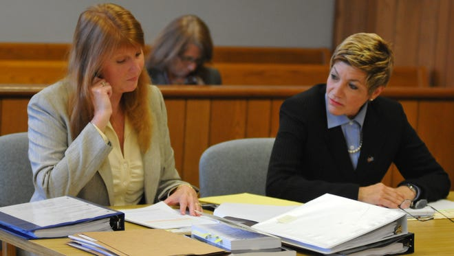 EDC Chief Executive Officer Lynda Weatherman, right, and EDC attorney Kim Rezanka sit in court regarding a lawsuit filed by Brevard Clerk of Court Scott Ellis.  MALCOLM DENEMARK/FLORIDA TODAY A hearing was held Friday morning at the Titusville Courthouse before Judge Dean Moxley Jr. on access to public records concerning Blueware. Kim Rezanka, attorney for the EDC, sitting with Lynda Weatherman at the hearing.