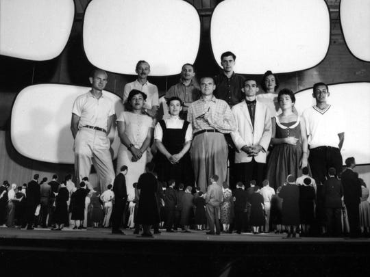 "From ""The World of Charles and Ray Eames,"" exhibit, a photo of the Eames Office staff posing in model for ""Glimpses of the U.S.A."" for the American National Exhibition, Moscow 1959."