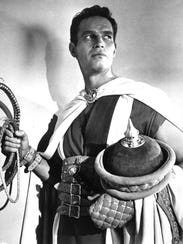 Actor Charlton Heston poses in character, in the title