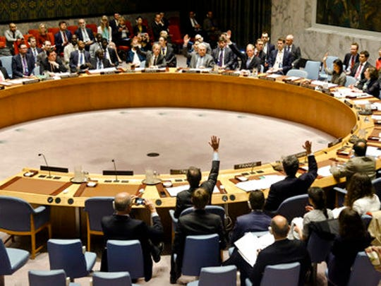 United Nations Security Council members show hands for a vote on a resolution condemning Syria's use of chemical weapons at U.N. headquarters on Wednesday, April 12, 2017.