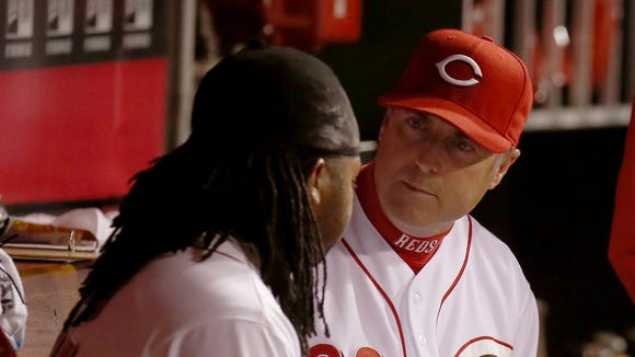 Price talks with starting pitcher Johnny Cueto in the dugout against Tampa Bay Rays after the 5th inning. Cincinnati Reds battles the Tampa Bay Rays on April 11th.