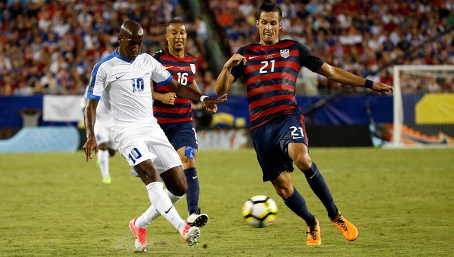 Jul 12, 2017; Tampa, FL, USA; Martinique forward Steeven Langil (10) shoots the ball as USA defender Matt Hedges (21) defends during the second half at Raymond James Stadium.