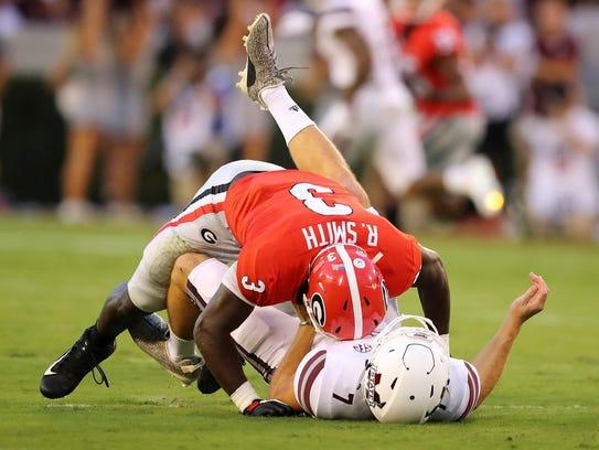Georgia linebacker Roquan Smith levels Mississippi State quarterback Nick Fitzgerald on Sept. 23, 2017.