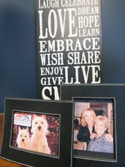 Sue DeStephano, the new president and CEO of First Capital Federal Credit Union has several photos in her office including one of her with her mother, Lucy Warner, who taught in the Eastern York School District. The other photo shows DeStephano's two West Highland White Terriers, Louie and Sunny.