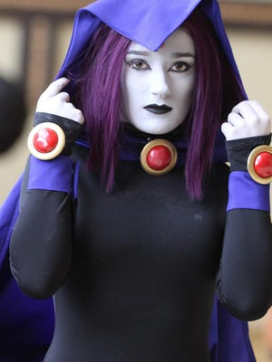 Jesse Paratore of Staten Island helps friend Alanda Bessette of Connecticut with costume. She is dressed as Raven from Teen Titans. Participants of Cosplay Collectible Convention dress as superhero and comic book characters at Hyatt Morristown. Saturday, Jan. 28, 2017. Special to NJ Press Media/Karen Mancinelli/Daily Record MOR 0128 cosplay morristown MOR 0128 cornhole Morristown MOR 0128 cosplay