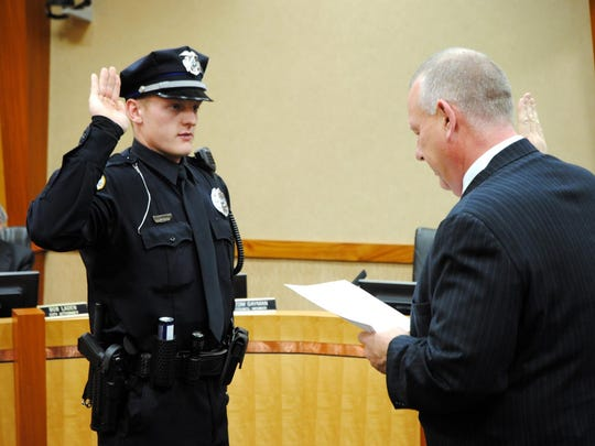 Justin Martin, left, is sworn in as an Urbandale Police