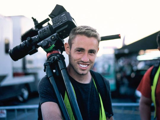 Filmmaker Jesse Wood on a photo shoot at a racetrack,