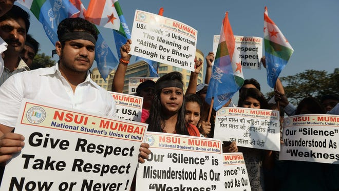 National Student's Union of India activists hold placards during a protest outside the U.S.  Consulate in Mumbai on Dec. 20. India angrily brushed aside fresh efforts by the United States to defuse a spat over the arrest and strip-search of one of its diplomats.