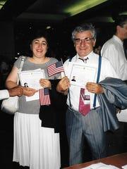 Baku refugees Karine and Levon Sarkisian, of Holt, celebrate their U.S. citizenship shortly after arriving in Lansing.