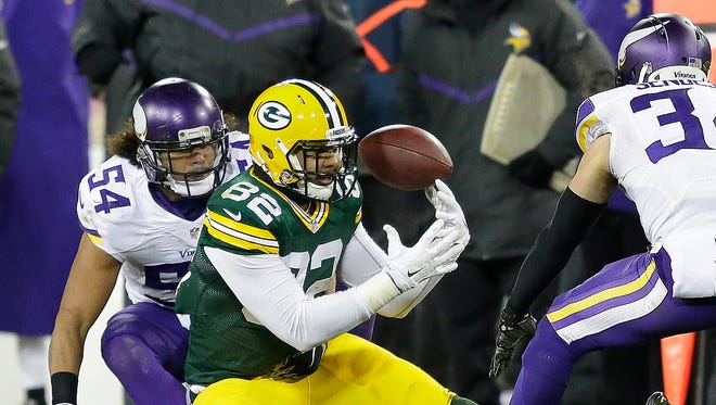 Green Bay Packers tight end Richard Rodgers bobbles the ball on third down during the second quarter against the Minnesota Vikings at Lambeau Field. The play was ruled a catch, but Rodgers was short of a first down.