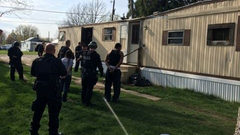 Authorities search a suspected drug house Friday at 1203 Monnett St., Bucyrus.