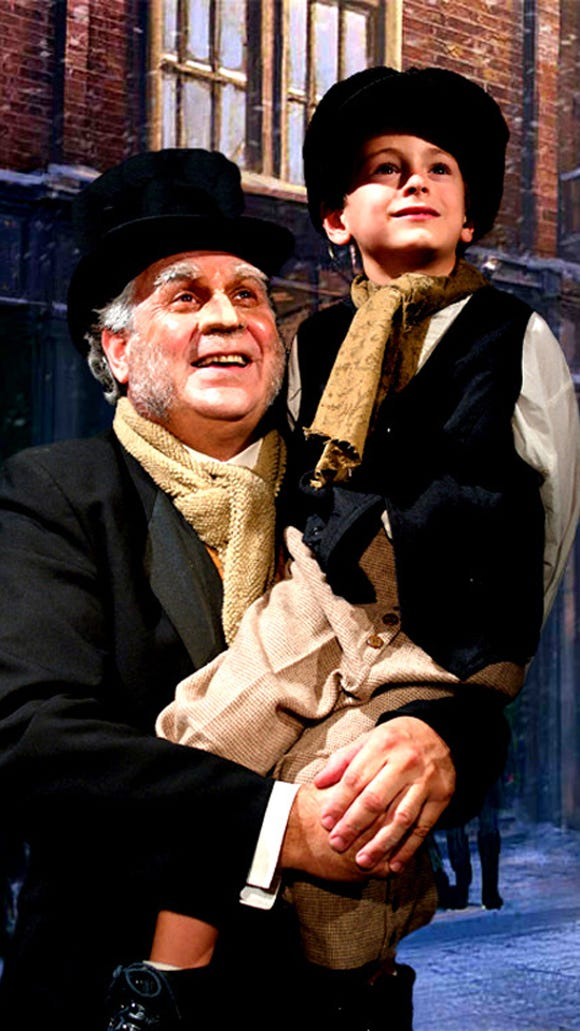 Southwest Shakespeare Company production of A CHRISTMAS CAROL. Pictured: Jared Sakren as Scrooge and Reno Lock as Tiny Tim. Credit: Southwest Shakespeare Company.