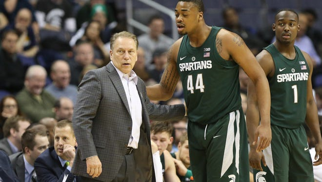 Michigan State coach Tom Izzo talks to freshman Nick Ward in the second half of Friday's Big Ten tournament loss to Minnesota.