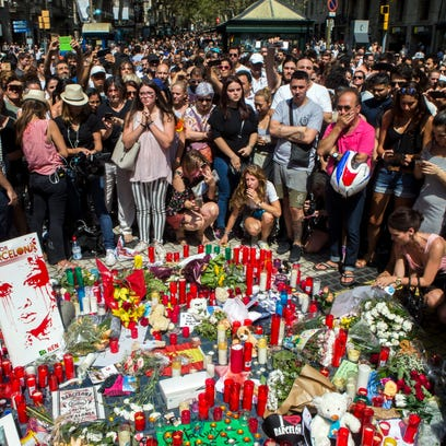 People pay tribute to victims outside the Liceu Theatre,