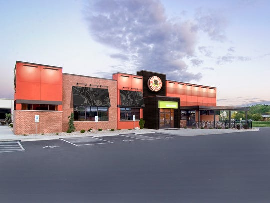 Buffalo Wings & Rings is under construction next to