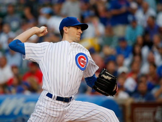 Chicago Cubs starting pitcher Kyle Hendricks delivers during the first inning of a baseball game against the Cincinnati Reds Tuesday, Aug. 15, 2017, in Chicago. (AP Photo/Charles Rex Arbogast)