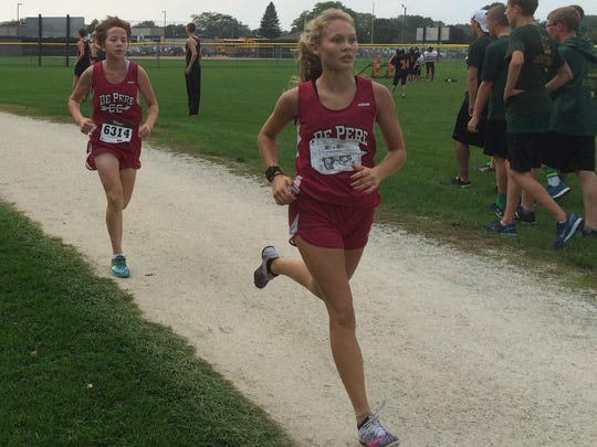 De Pere junior Hailey Dorn and freshman Aisa Longnecker move through the trail in the first mile of the Jim Bremser Memorial Invite at Mishicot on Thursday. Dorn placed third, while Longnecker finished fifth in the girls varsity cross-country race.